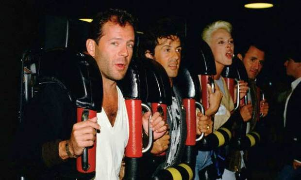 Bruce-Willis-Sylvester-Stallone-Brigitte-Nielsen-and-Frank-Stallone-on-a-roller-coaster